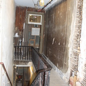 The entryway to the boarding house and the rooms that were the Clara Barton Missing Soldiers Office during the restoration. It's torn apart, the bones of the building exposed.