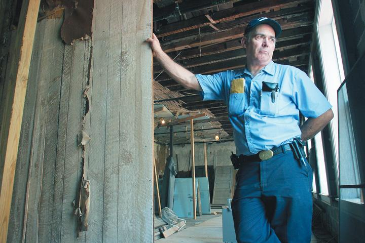 Richard Lyons stands in Clara Barton's Missing Soldiers Office during the renovation