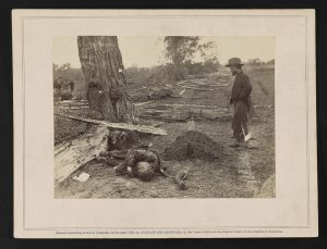 A buried Union soldier and an unburied Confederate soldier near the West Woods at Antietam (Courtesy of the Library of Congress)