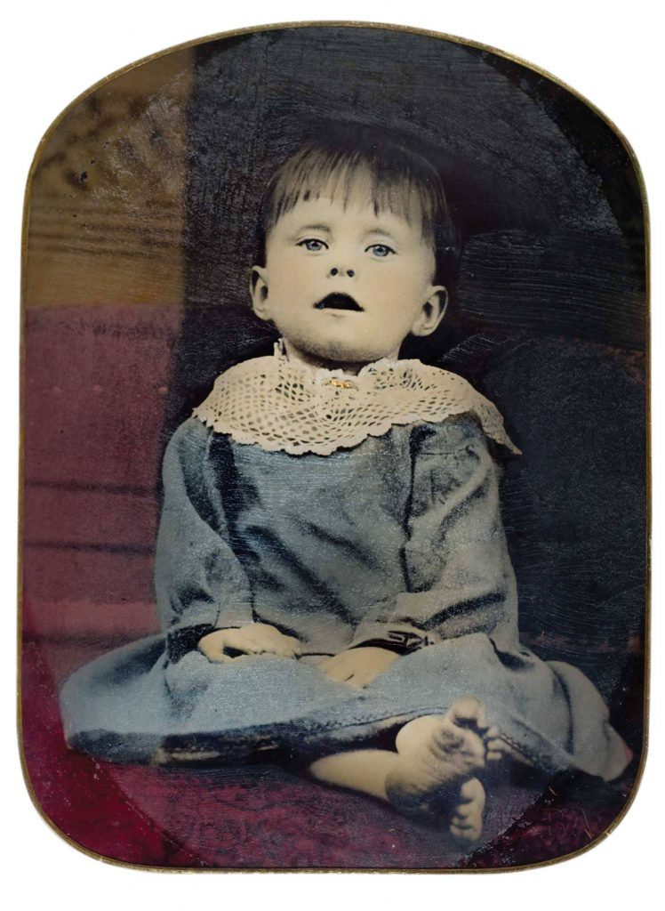 This child's eyes are hand-painted open on tintype, circa 1870. Image via Burns Archive via HIstory.com